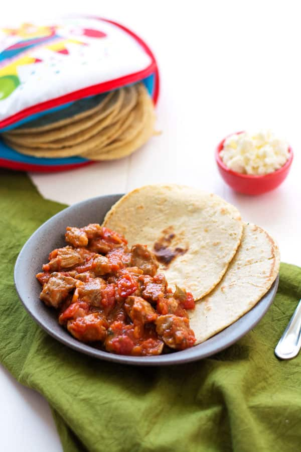 Mexican Pork Stew (Puerco en Salsa Roja) is an easy dinner with only 2 ingredients! Serve with homemade corn tortillas.