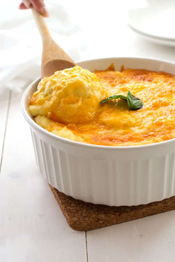 Cheesy mashed potato casserole that tastes like the inside of twice baked potatoes without all the fuss! With cheddar and cream cheese this is sure to become a family favorite!