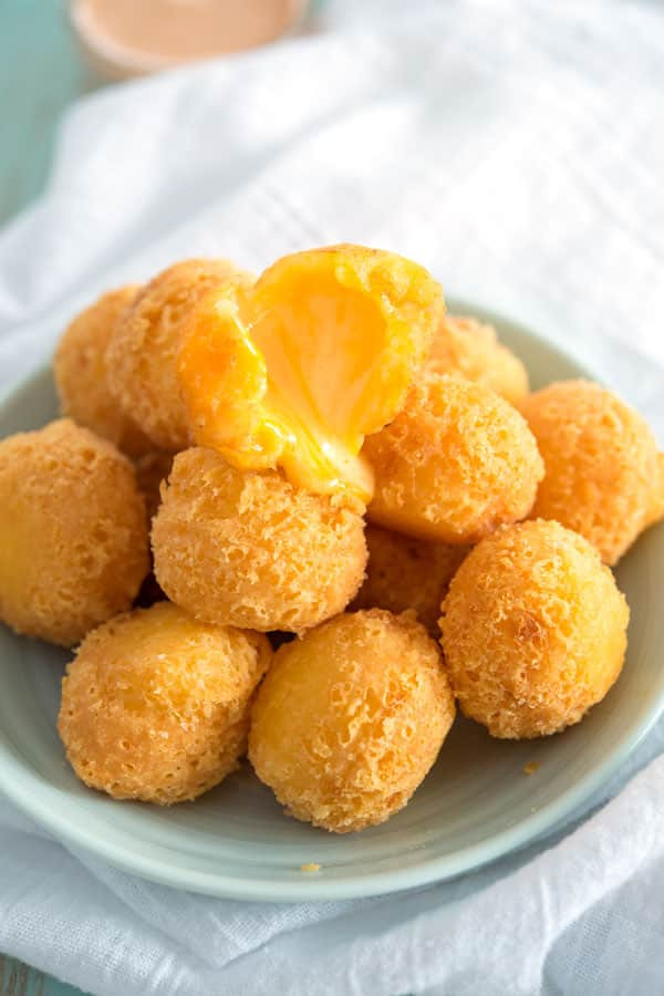 Hot bolitas de queso (deep fried cheese balls) with melted, gooey cheese. Easiest appetizer ever!