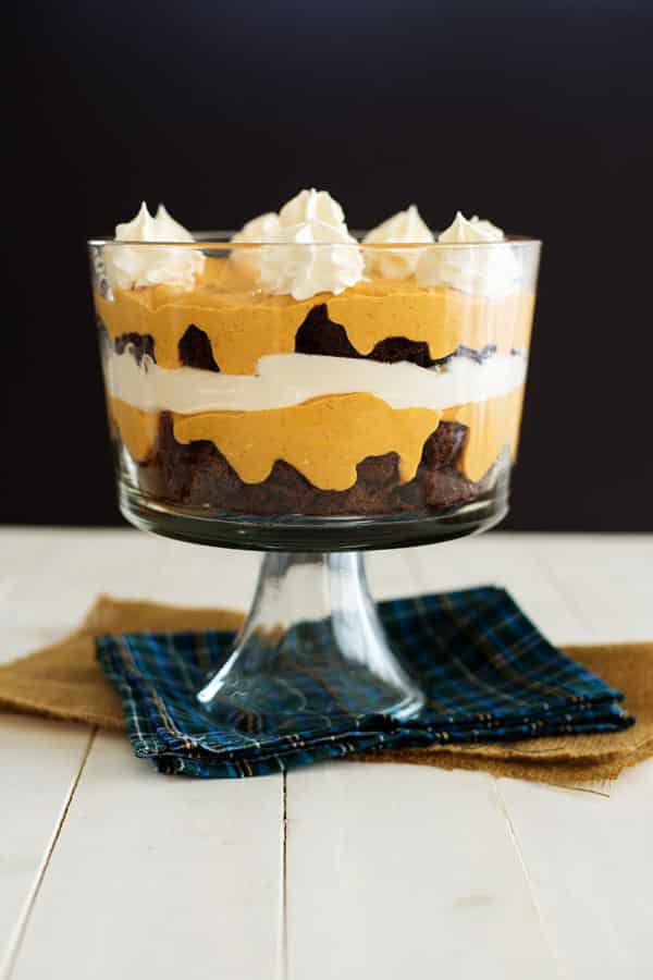 Layers of fudgy chocolate brownies, pumpkin cheesecake pudding and warm pumpkin spice combine in this festive dessert. Pumpkin brownie trifle is an easy yet stunning dessert to make this holiday season!