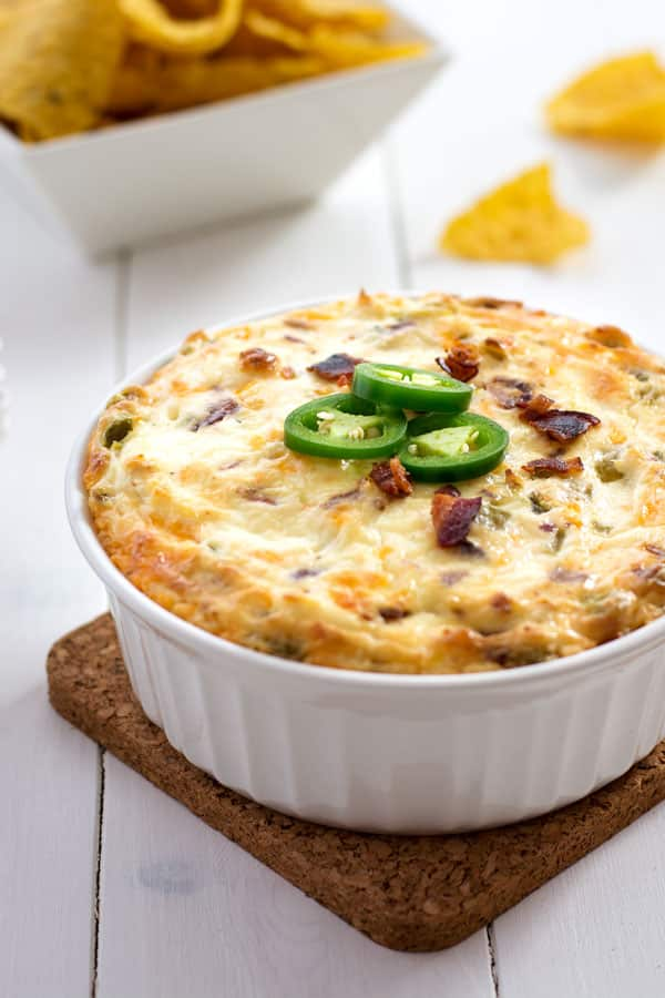 Jalapeño cream cheese dip loaded with green chiles, cheddar cheese and bacon! It doesn't get any better than this addicting dip!