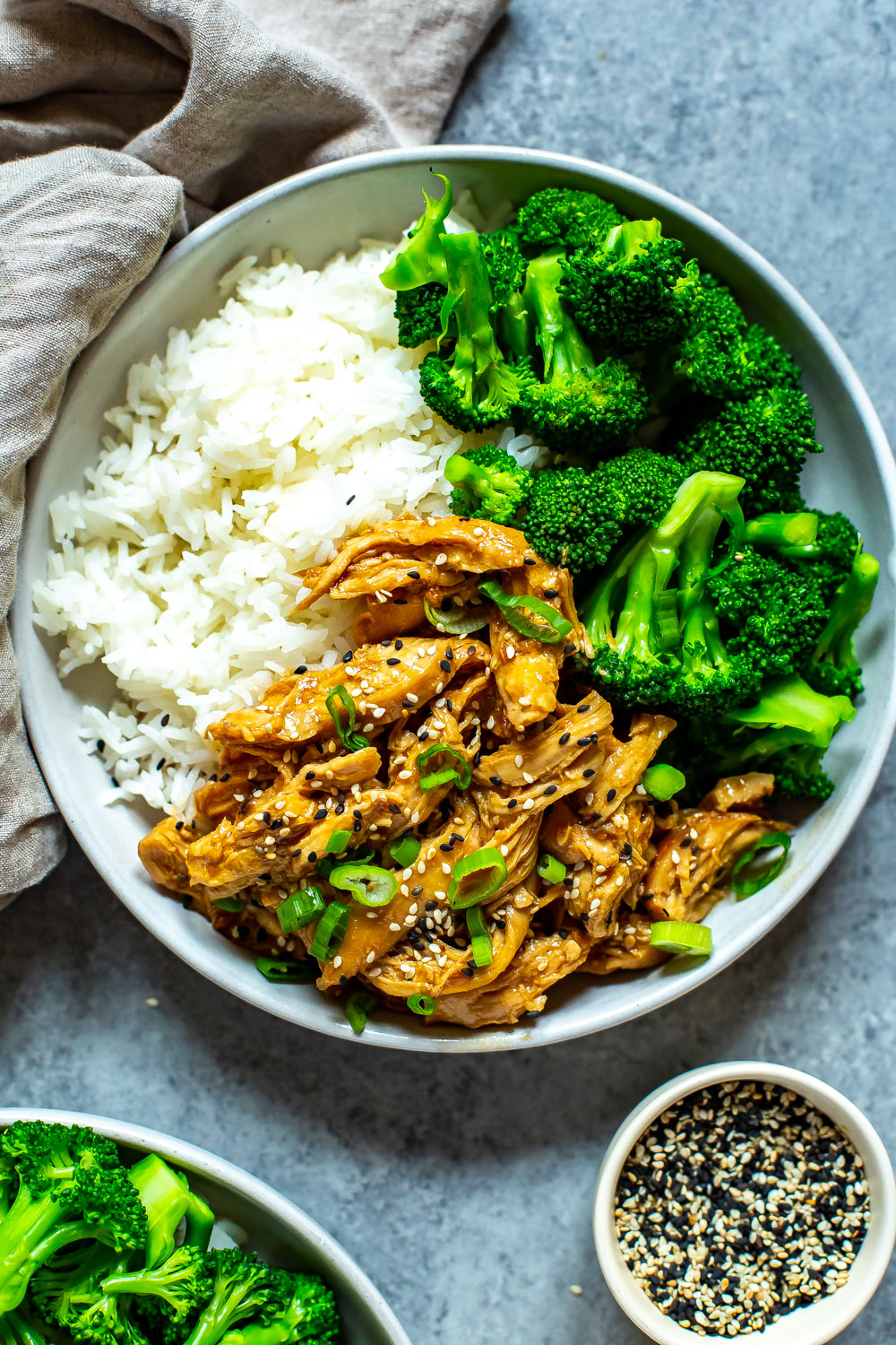 dinner plate with teriyaki chicken, rice, and broccoli