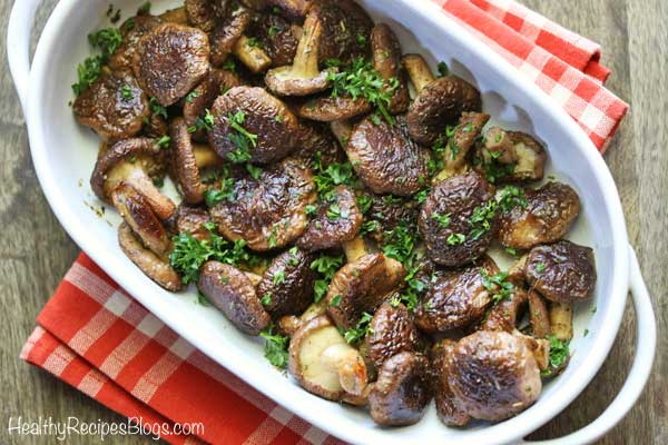 Oven baked shiitake mushrooms in white dish