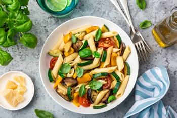 thumbnail size vegetable pasta on white plate