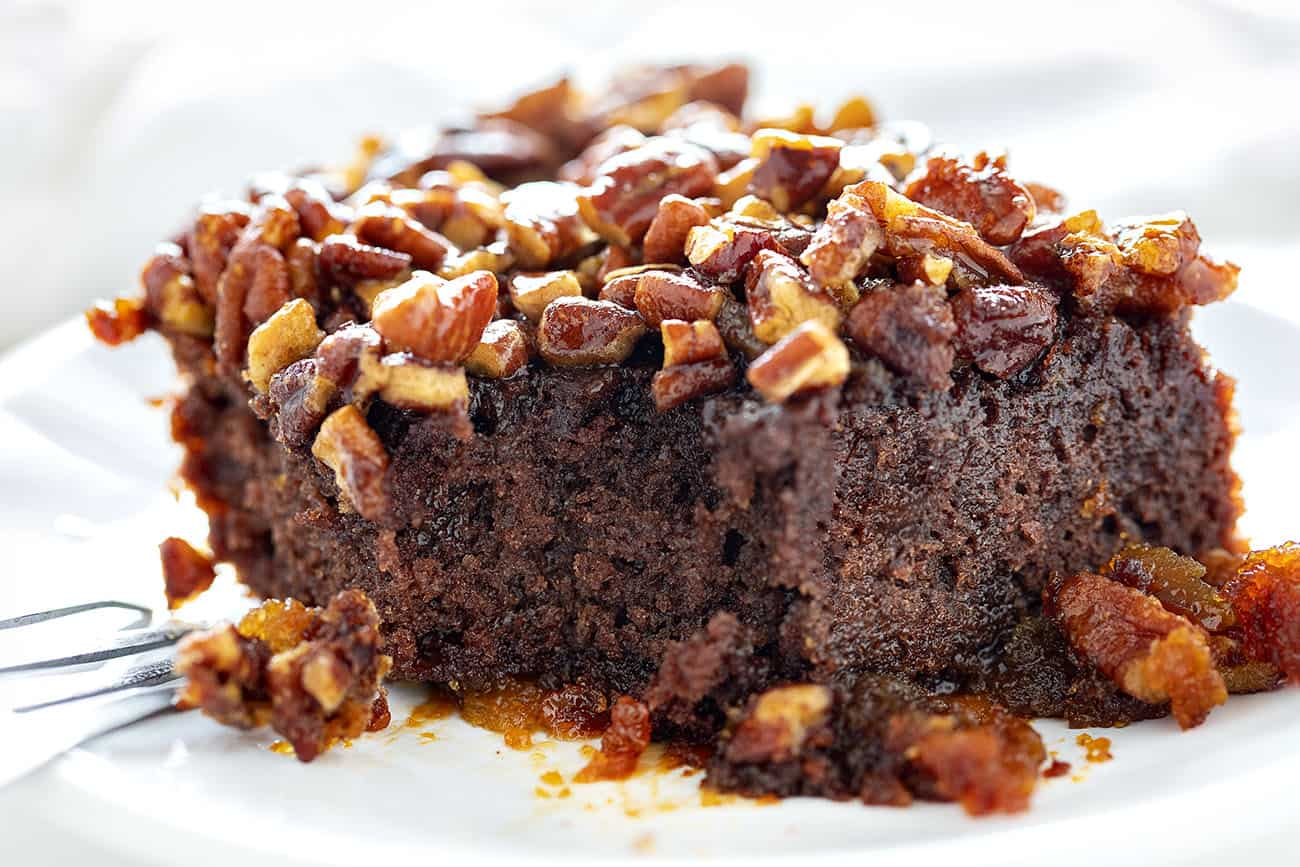 Ooey Gooey Pecan Brownies with a bite taken out