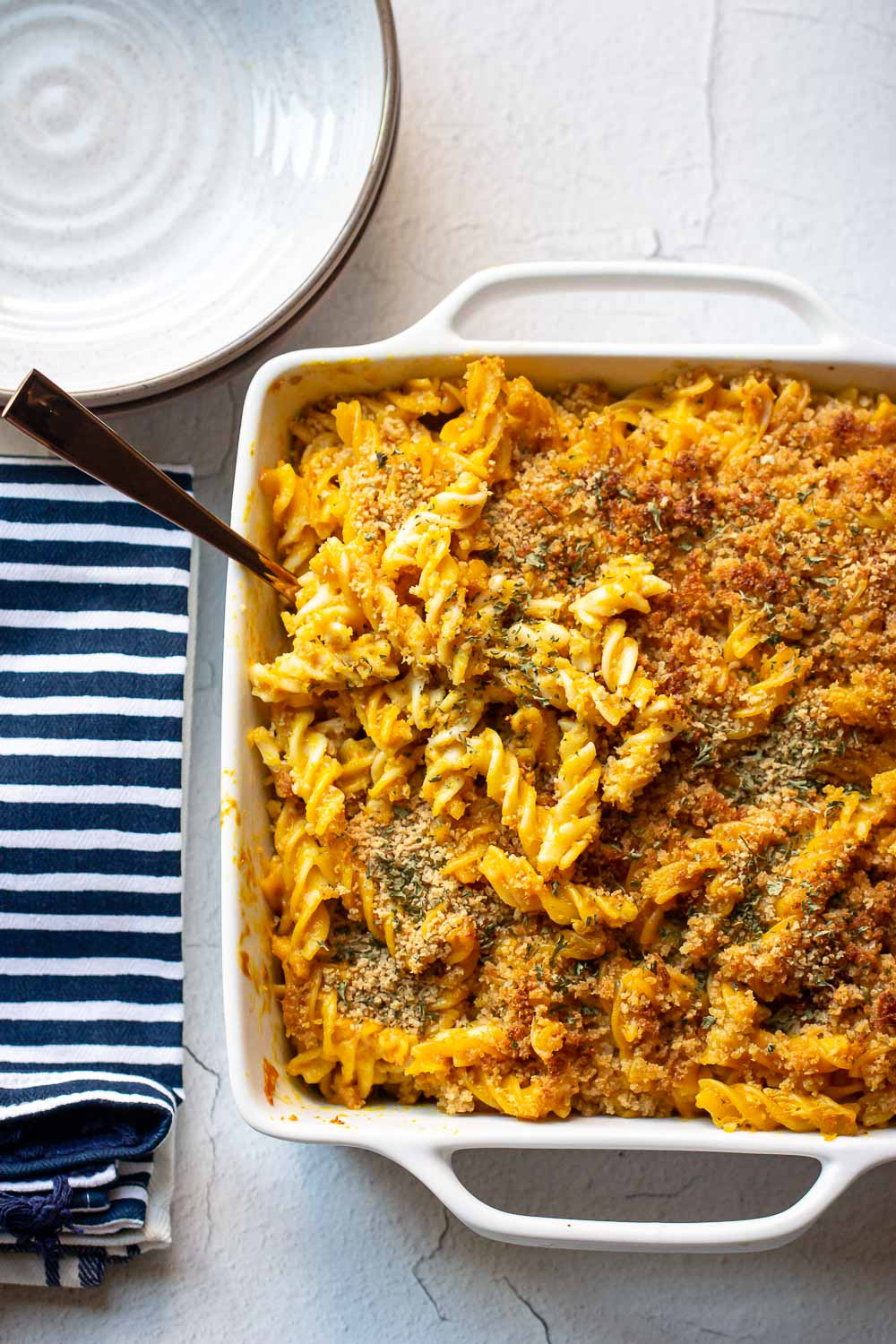 This easy pumpkin mac and cheese recipe is a must-try recipe! Pumpkin puree adds a taste of sweet and savory and creaminess to this cheesy macaroni. The perfect fall dinner!