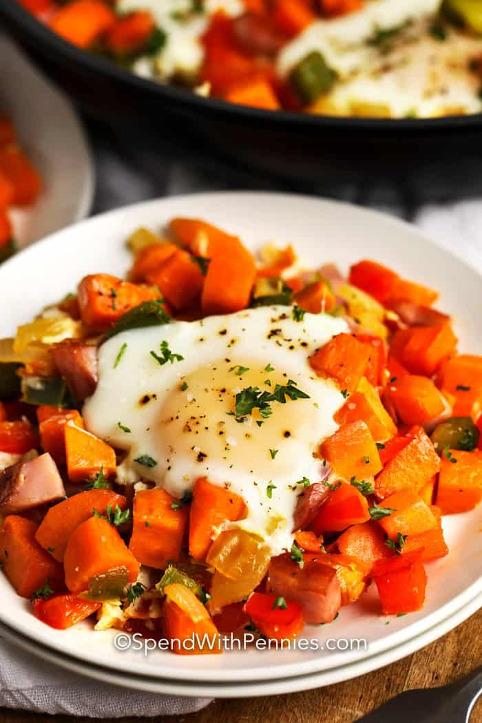 Close up image of Sweet Potato Hash on a white plate garnished with parsley.