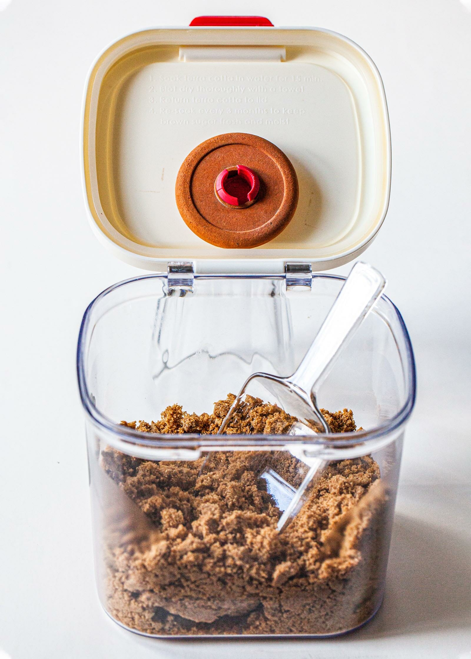 How to soften brown sugar by putting it in a brown sugar keeper.