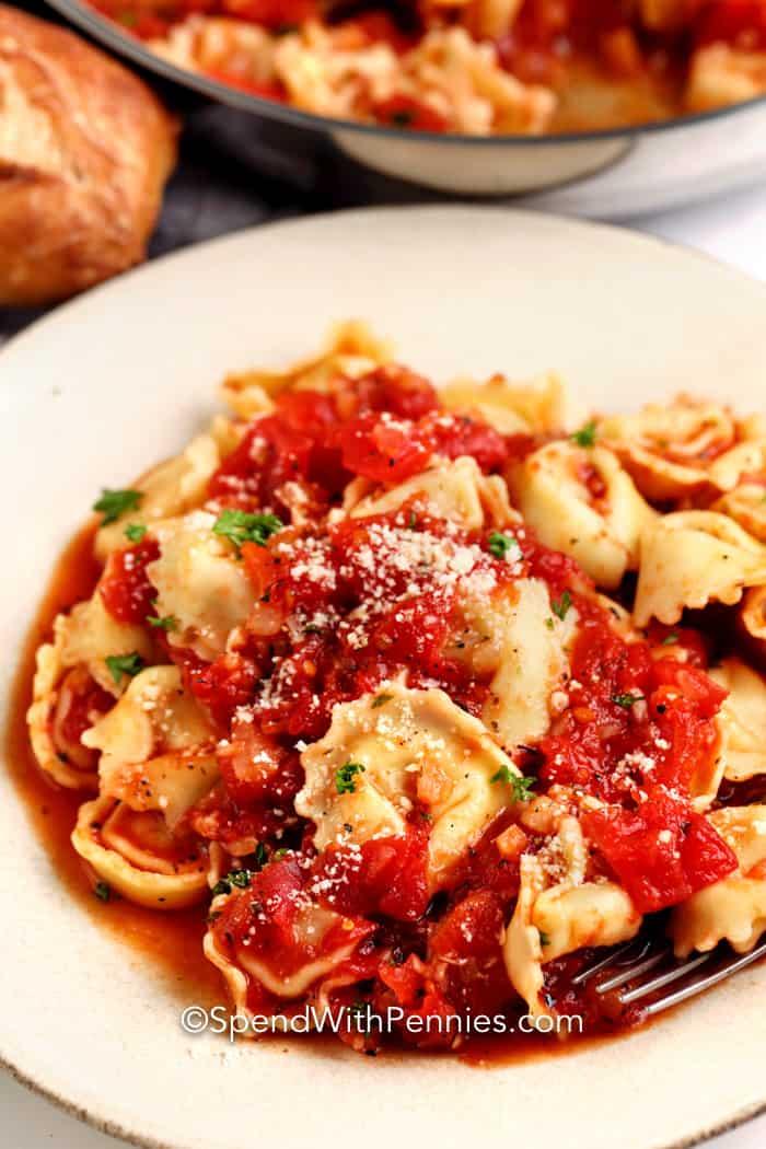 Garlic Tomato Tortellini in a white bowl