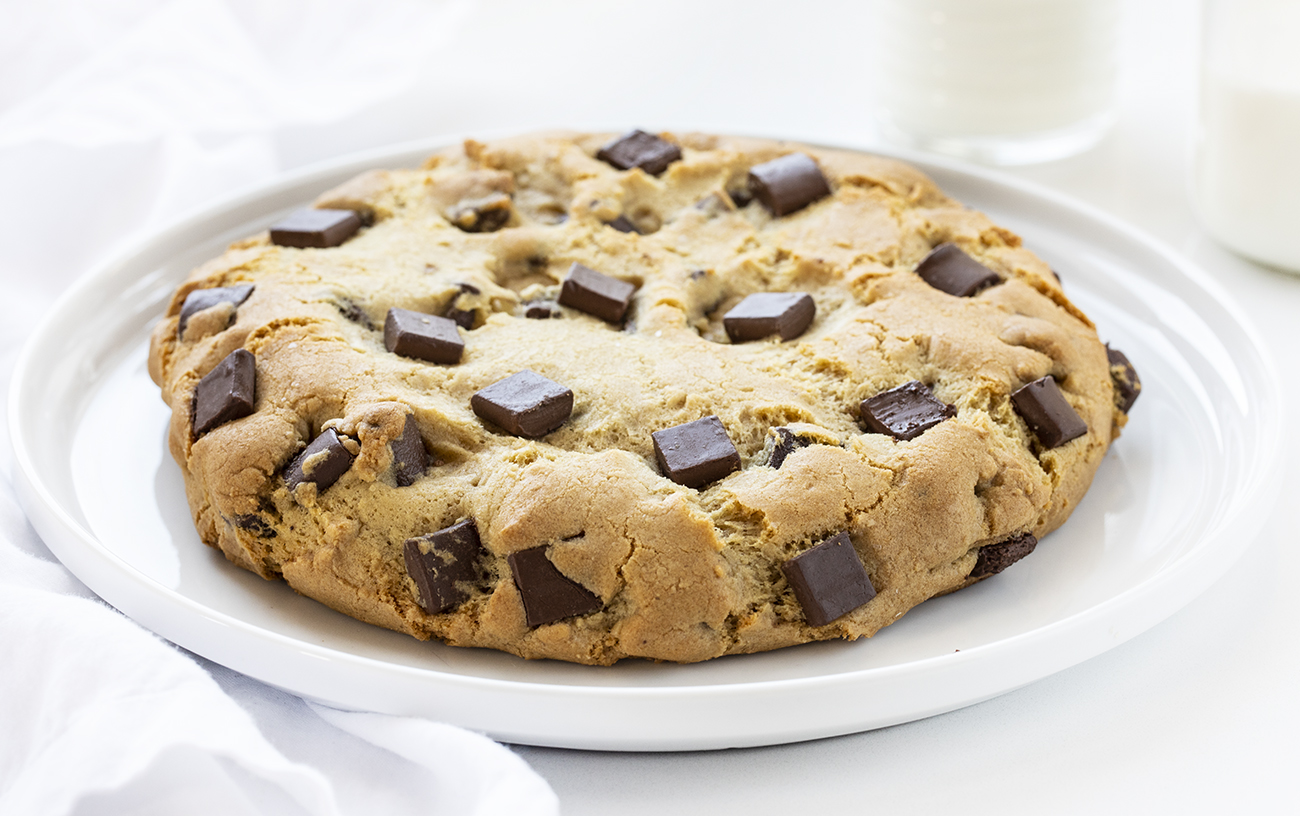 TikTok Giant Chocolate Chip Cookie on a White Plate with Milk
