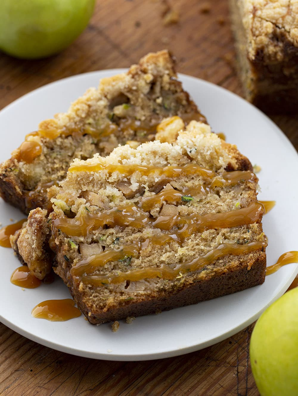 Two Pieces Apple Zucchini Bread on a Plate Drizzled with Caramel